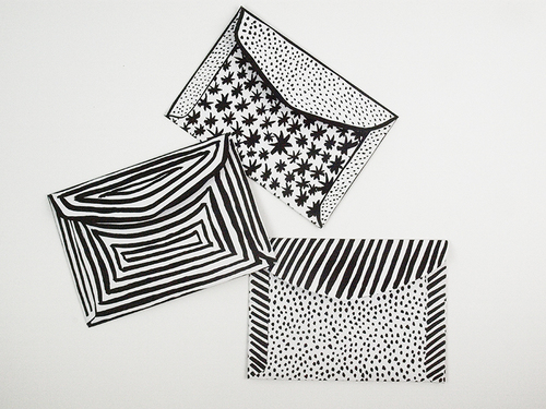 Black and white illustrated envelopes