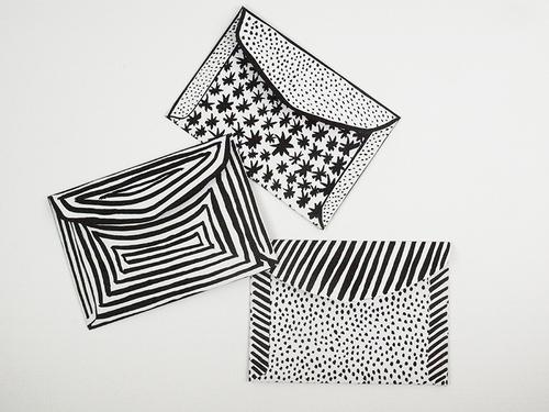 Black and white illustrated envelopes